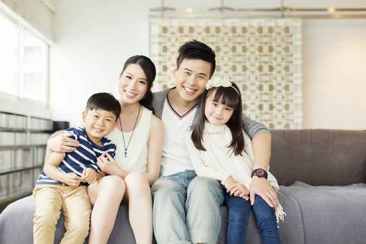 asian family in a dental office waiting room